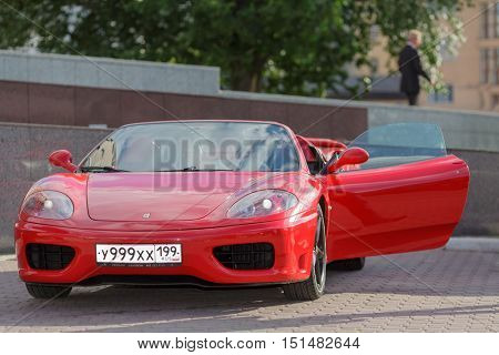 MOSCOW, RUSSIA - JUN 22, 2016: Ferrari 360 Spider parking the side road.