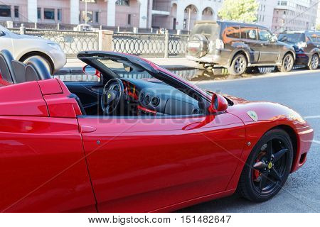 MOSCOW, RUSSIA - JUN 22, 2016: luxurious red roadster, Ferrari 360 Spider, on city street