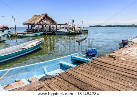 Livingston Guatemala - August 31 2016: Boats moored by dock in Caribbean town of Livingston