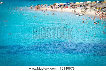 Teulada Italy - August 18 2016: Tuerredda is considered one of the most beautiful beaches in Sardinia for its white sand and the clear color of the sea which recalls a Caribbean landscape.