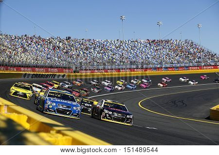 Concord, NC - Oct 09, 2016: Jimmie Johnson (48) and Austin Dillon (3) lead the field to a restart during the Bank of America 500 at the Charlotte Motor Speedway in Concord, NC.
