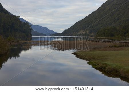 Wooden pier jutting out into a scenic lake (Lago Risopatron) located along the Carretera Austral in the Aysen Region of southern Chile.