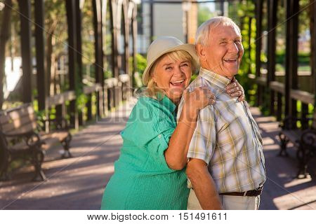 Elderly woman hugs man. Senior couple laughing. Love becomes stronger with time. As years go by.