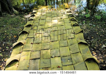 Unusual small boat ramp made from old interwoven fire hoses.