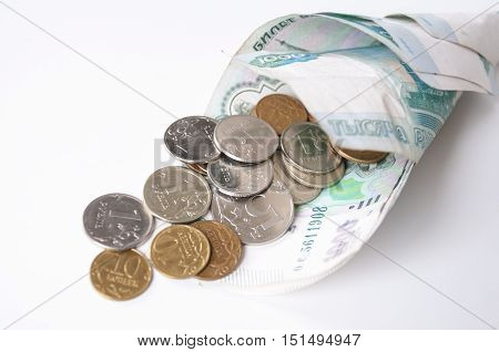 Small coins in the bags of money on a white background