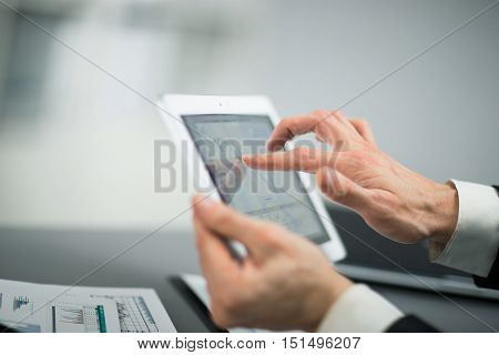 Businessman with finger touching screen of a digital tablet