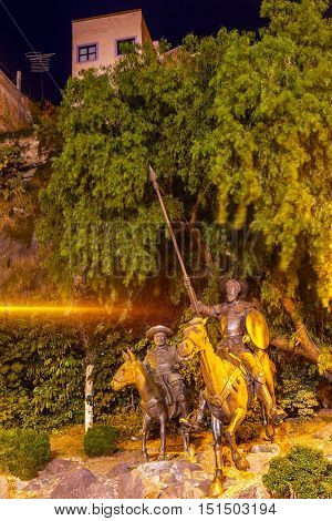 GUANAJUATO, MEXICO - DECEMBER 30, 2014 Famous Statue of Don Quixote and Sancho Panza night Plaza Allende Near Cervantes Theater Light Shaft Guanajuato Mexico. Guanajuato is in love with Cervantes the author and has a Cervantes Museum. This is one of the m