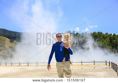 Young Happy Father With Little Daughter .  Wai-o-tapu Thermal Area, Nz