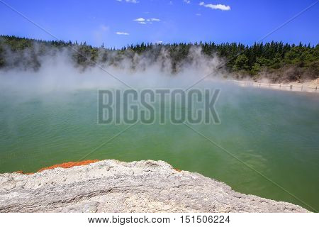 Wai-O-Tapu Thermal Wonderland inNew Zealand. Champagne Pool steam geothermal water lava crust