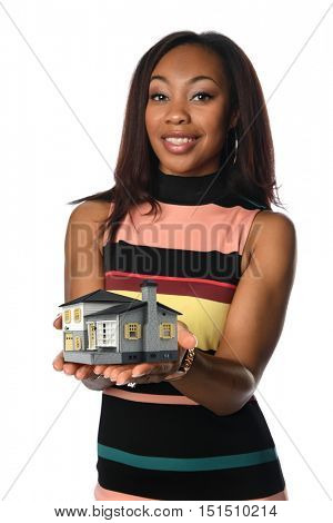 African American businesswoman holding miniature house isolated over white background -Selective Focus on hands