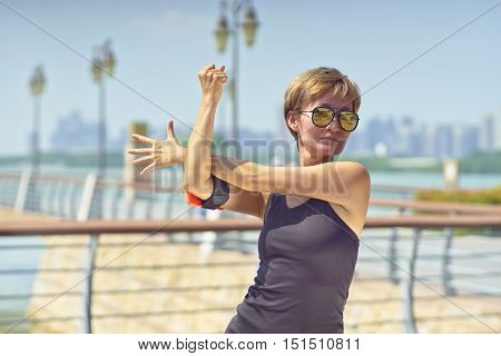 Young Asian Woman Stretching Arms In Exercise