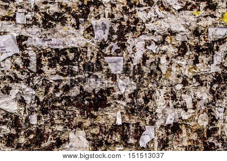 Bulletin board, abstract background, grunge texture, torn paper, torn posters, scraps paper, grunge background, abstraction, metal surface, torn bulletins