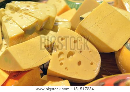 cheese on display in a big supermarket