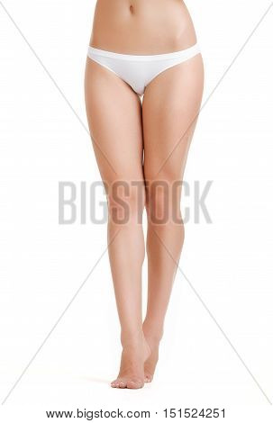 Legs-body part. Slim female legs on a white background. Beautiful female body isolated on white. Beautiful Woman. Perfect Body. Slim legs young woman in lingerie. Diet, healthy lifestyle.