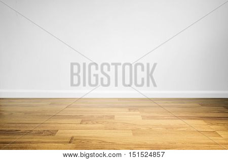 Laminated wood floor with white wall, interior space