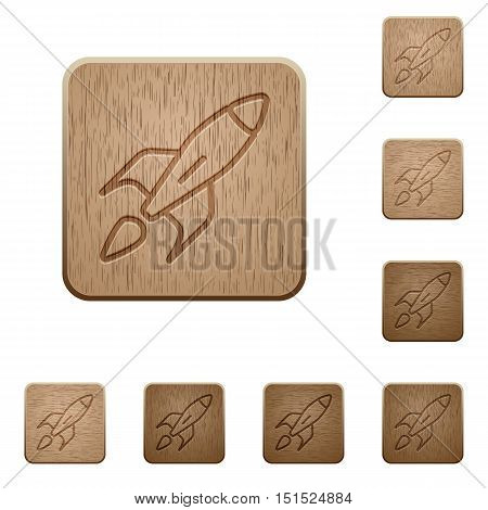 Set of carved wooden launched rocket buttons in 8 variations.