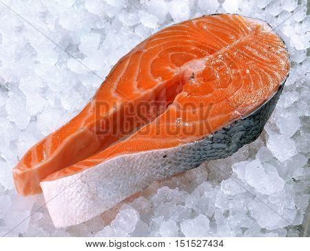 Fresh salmon steak on ice in a big supermarket