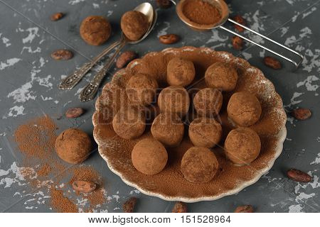 Homemade chocolate truffles on a gray background