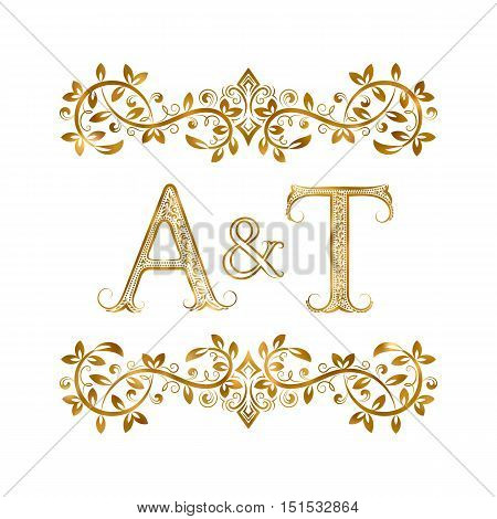 A&T vintage initials logo symbol. Letters A T ampersand surrounded floral ornament. Wedding or business partners initials monogram in royal style.