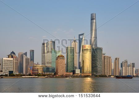 SHANGHAI CHINA - MARCH 25: Pudong district view from The Bund waterfront area on March 25 2016 in Shanghai China. Pudong is a district of Shanghai located east of the Huangpu River.