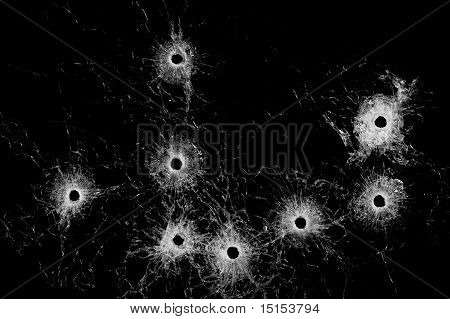 Broken Glass - Bullet Holes Isolated On Black