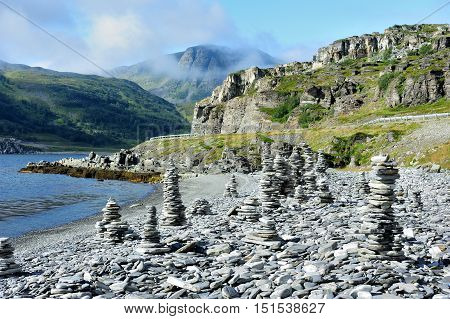 stone cairns on the coast of Goahtemuorjohka River Norway
