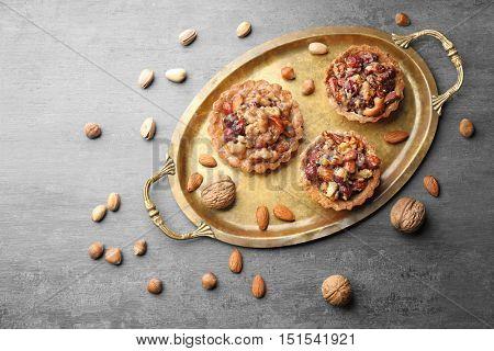 Tasty tart cakes on tray