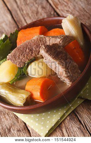 French Cuisine Pot-au-feu Soup Close Up In A Bowl. Vertical