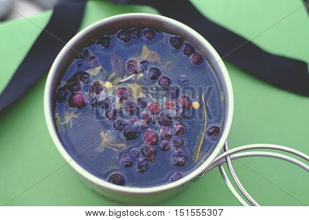Cup of tea with blueberries cup white afternoon drink