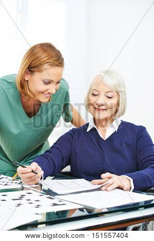 Senior woman doing memory training in nursing home