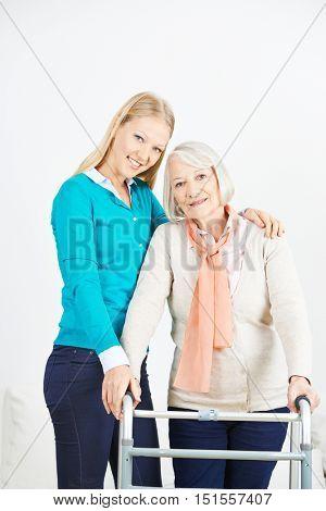 Granddaughter helping old senior woman at home