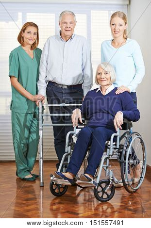 Geriatric caregiver with senior couple at home