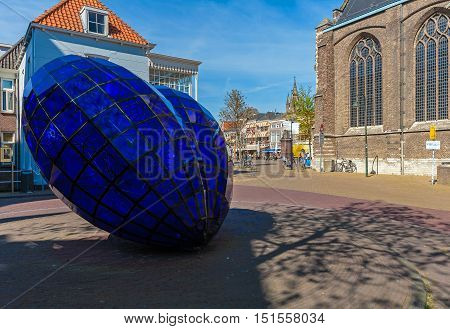 Delft, Netherlands - April 4, 2008:  Blue Glass Heart Near New Church
