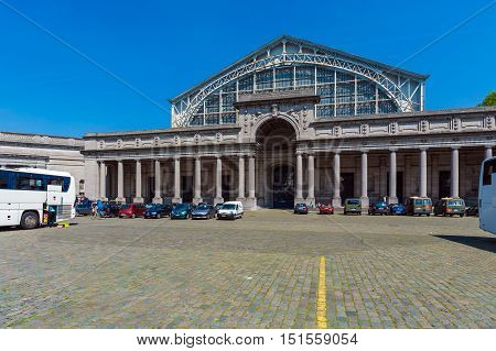 Brussels, Belgium - April 5, 2008: Tourists Walk In Front Of Entrance To The Palais Mondial (south H