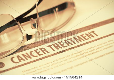 Cancer Treatment - Printed Blurred Text on Red Background with Spectacles. Medical Concept. 3D Rendering.