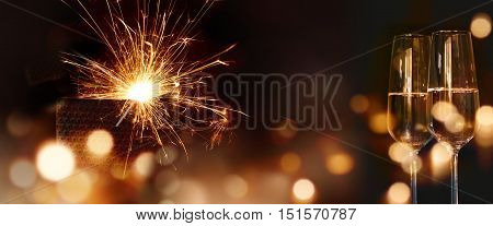 Sparkling New Year's wishes with two champagne glasses
