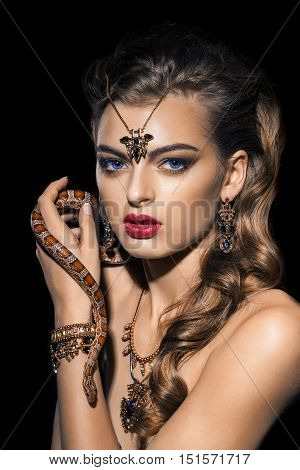 Close up portrait of sexy woman with snake. Beautiful red lips