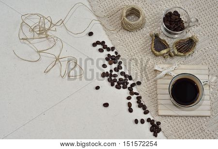 Abstract backround photo on organic paper with coffeebeans, espressocoffee, organic ribbon. Space for text.