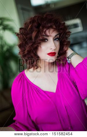 young girl with red short hair posing