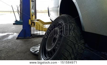 Changing summer with winter tires in a car service before the bad weather season