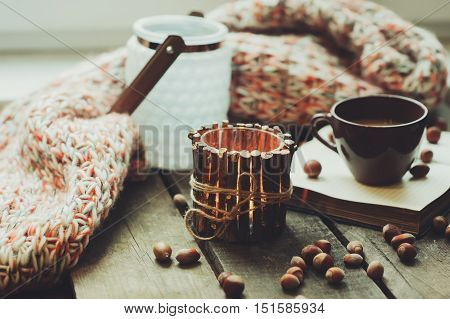cozy morning at home with handmade wooden candleholder and coffee selective focus vintage toned