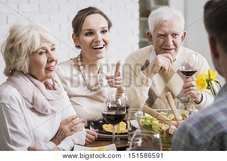 Family Members Drinking Wine