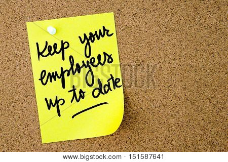 Keep Your Employees Up To Date Text Written On Yellow Paper Note