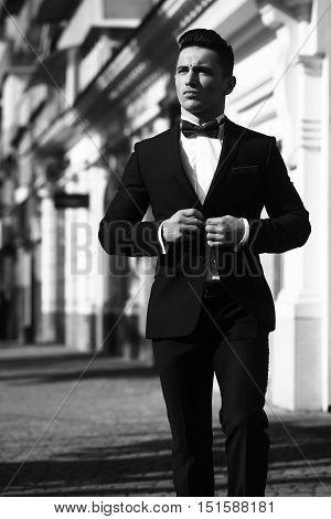 Elegant Man Unbuttons Suit Coat