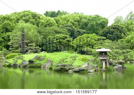 Japanese Outdoor Stone Lantern And Lake In Zen Garden