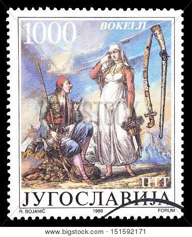 YUGOSLAVIA - CIRCA 1988 : Cancelled postage stamp printed by Yugoslavia, that shows Traditional weapons.