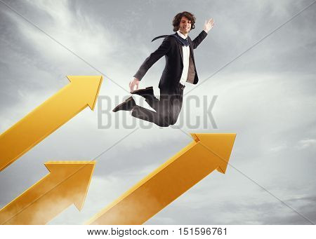 Businessman jumps on big arrows in the sky