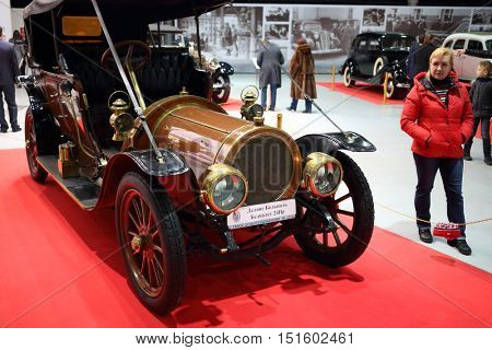 MOSCOW - MAR 07, 2016: People watch old cars on exhibition Oldtimer-Gallery in Sokolniki Exhibition Center. Text - Delaunay Belleville belvalet.  It is only one in Russia exhibition of vintage cars