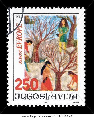 YUGOSLAVIA - CIRCA 1987 : Cancelled postage stamp printed by Yugoslavia, that shows Children drawing.