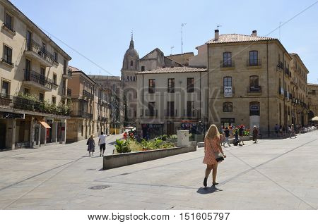 SALAMANCA, SPAIN - AUGUST 3, 2016: People in a plaza in the historical part of Salamanca Spain
